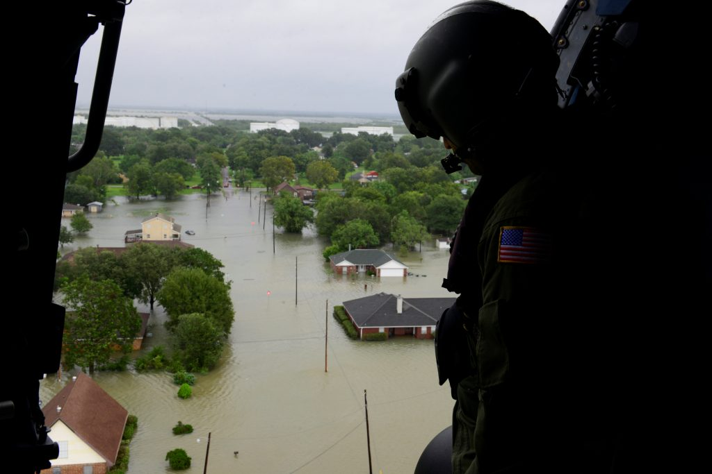 A Coast Guard helicopter searches areas hit by flood waters due to Tropical Storm Harvey in Beaumont, Texas, U.S. August 30, 2017. U.S. Coast Guard/Petty Officer 3rd Class Brandon Giles/Handout via REUTERS. ATTENTION EDITORS - THIS IMAGES WAS PROVIDED BY A THIRD PARTY. - RC1A16E97200