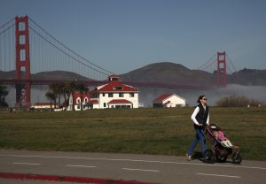 A woman walks with a child along Crissy Field in The Presidio of San Francisco, part of the Golden Gate National Recreation Area, in San Francisco, California March 1, 2013. Photo by Robert Galbraith/REUTERS