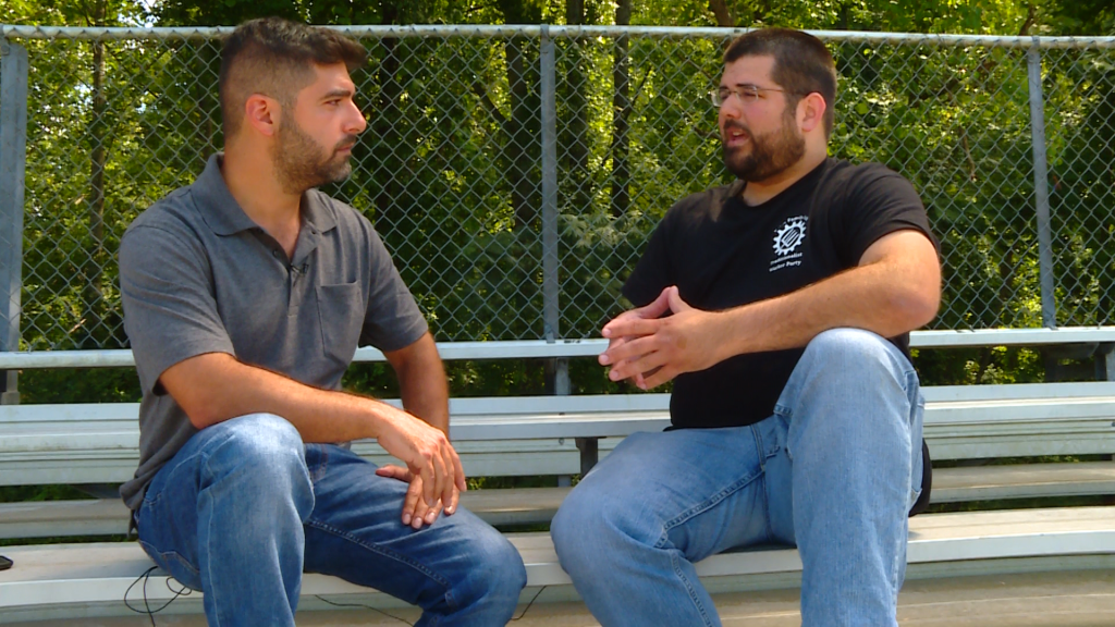 NewsHour's P.J. Tobia interviews Matthew Heimbach after one person was killed and 19 more injured in an automobile attack following a white nationalist march in Charlottesville, Virginia. Photo image by Mark Scialla/NewsHour