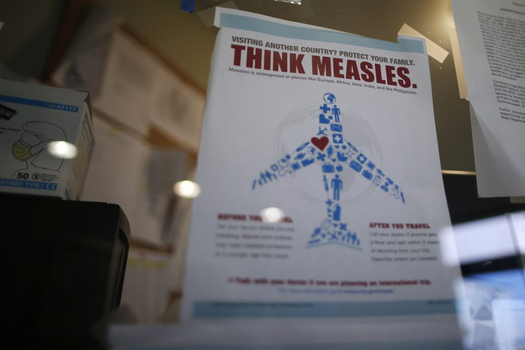 A measles poster is seen at Venice Family Clinic in Los Angeles, California February 5, 2015. Lawmakers in several U.S. states are backing proposals to make it harder for parents to opt out of school vaccinations based on personal beliefs, as health officials fight a growing measles outbreak that has sickened more than 100 people in more than a dozen states. REUTERS/Lucy Nicholson (UNITED STATES - Tags: HEALTH POLITICS) - RTR4OFFV