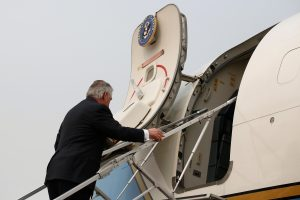 U.S. State of Secretary Rex Tillerson boards a plane at the airport in Beijing