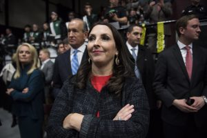 """GRAND RAPIDS, MI - DECEMBER 9: Michigan Republican Party Chairman Ronna Romney McDaniel listens as President-Elect Donald J. Trump speaks at a """"USA Thank You Tour 2016"""" event at the DeltaPlex in Grand Rapids, Mi. on Friday, Dec. 09, 2016. (Photo by Jabin Botsford/The Washington Post via Getty Images)"""