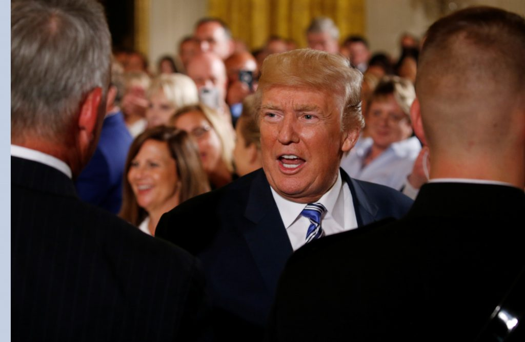 U.S. President Donald Trump greets guests during an event with small businesses in the East Room of the White House in Washington, U.S., August 1, 2017. REUTERS/Jonathan Ernst - RTS1A0XX