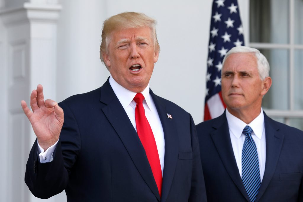 President Donald Trump speaks to reporters with Vice President Mike Pence at his side Aug. 10 at Trump's golf estate in Bedminster, New Jersey. Photo by REUTERS/Jonathan Ernst.