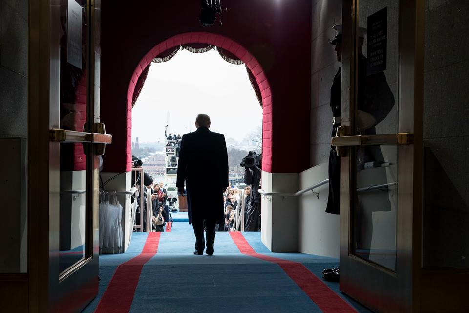President-elect Donald Trump walks to take his seat for the inaugural swearing-in ceremony at the U.S. Capitol in Washington, D.C., Friday, Jan. 20, 2017. (Official White House Photo by Shealah Craighead)