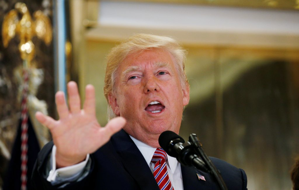 """U.S. President Donald Trump answers questions about his responses to the violence, injuries and deaths at the """"Unite the Right"""" rally in Charlottesville as he talks to the media in the lobby of Trump Tower in Manhattan, New York, U.S., August 15, 2017. REUTERS/Kevin Lamarque - RTS1BXGW"""