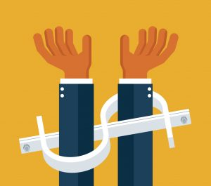 Dollar sign as handuffs on businessman