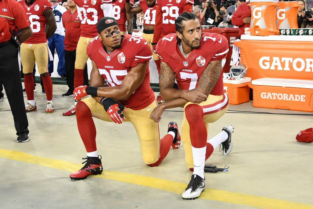 Colin Kaepernick and Eric Reid of the San Francisco 49ers kneel in protest during the national anthem prior to playing the Los Angeles Rams in their NFL game at Levi's Stadium on September 12, 2016 in Santa Clara, California. (Photo by Thearon W. Henderson/Getty Images)