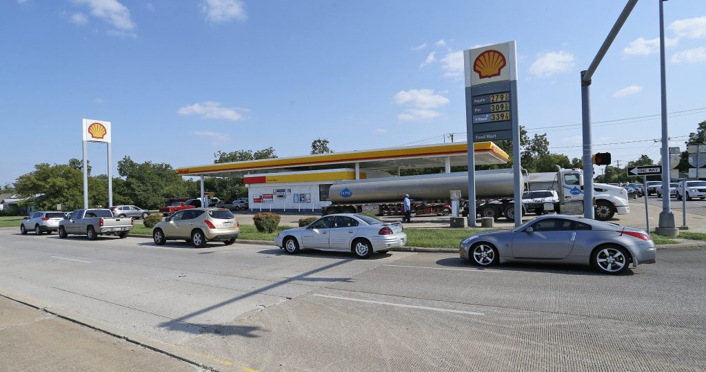 A line of cars surrounds the Shell station at Calmont Avenue and Bryant Irvin Road in Fort Worth, Texas, with a tanker from Dupre' Logistics, LLC in its driveway as the public becomes concerned about gasoline supplies due to Hurricane Harvey damage in Houston. (Paul Moseley/Fort Worth Star-Telegram/TNS via Getty Images)