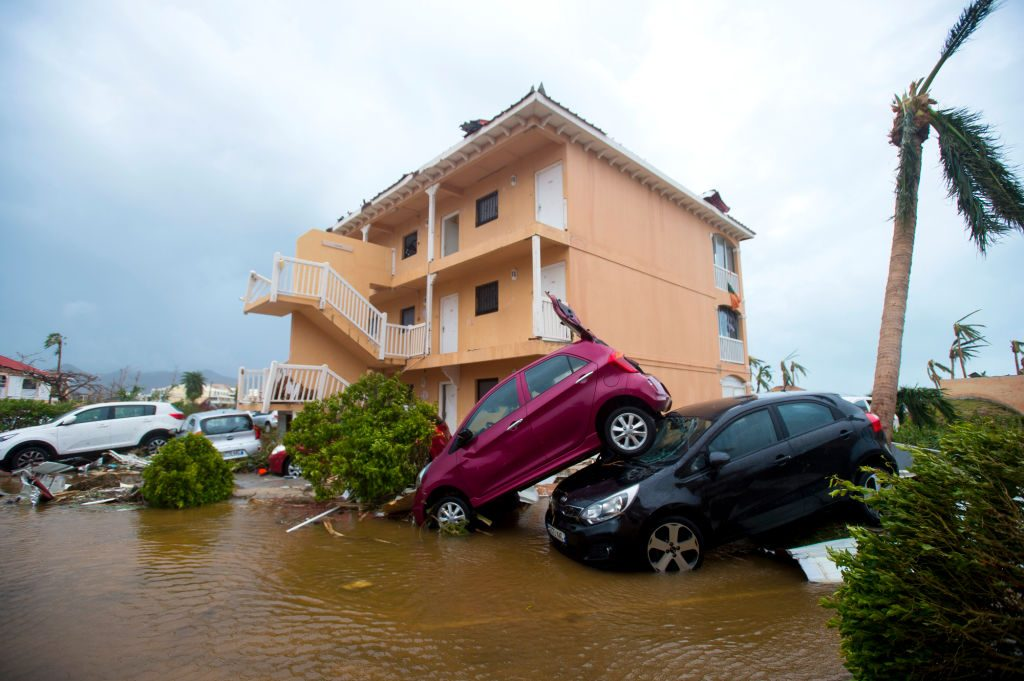 Cars piled on top of one another in Marigot, Saint Martin. Hurricane Irma has killed at least 10 people. Photo by Lionel Chamoiseau/AFP/Getty Images