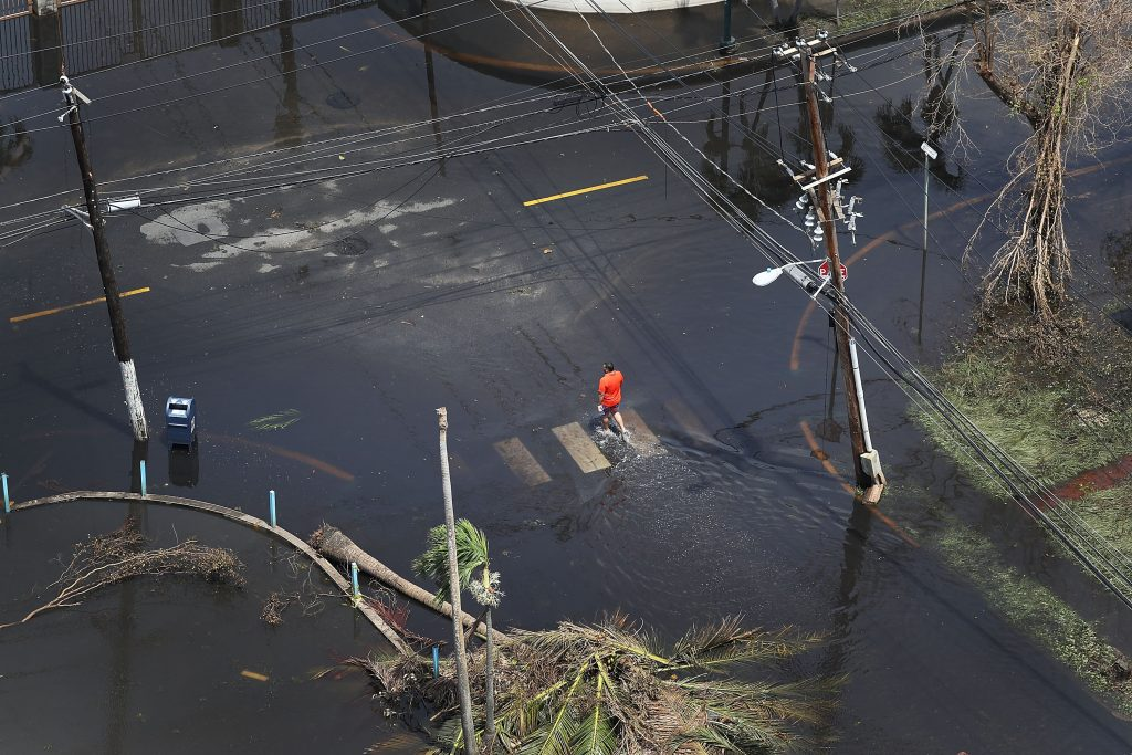 A street in San Juan, Puerto Rico remains flooded days after Hurricane Maria decimated the island. Photo by Joe Raedle/Getty Images.