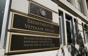 The sign of the Department of Veteran Affairs is seen in front of the headquarters building in Washington