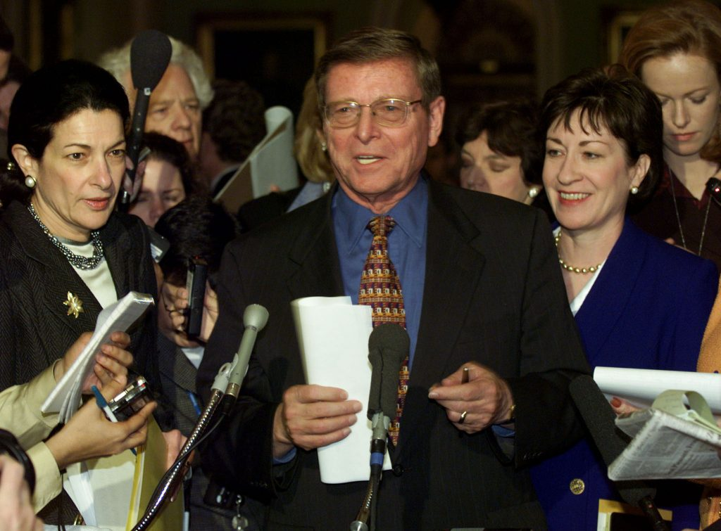 Sen. Pete Domenici, R-N.M., speaks to the press next to fellow senators Olympia Snowe, R-Maine, (left) and Susan Collins (R-Maine) in this file photo from Feb. 4, 1999. Photo by Kevin Lamarque/Reuters