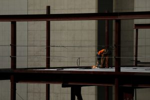 A welder works on a building in downtown Los Angeles, California, U.S. August 10, 2017. REUTERS/Mike Blake - RC1C95116A40