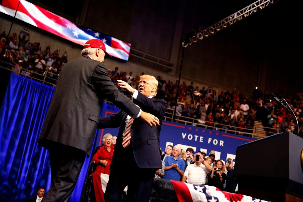 U.S. President Donald Trump greets Senator Luther Strange (R-AL) during a campaign rally in Huntsville, Alabama, U.S. September 22, 2017. REUTERS/Aaron P. Bernstein - RC1E1DC75D30