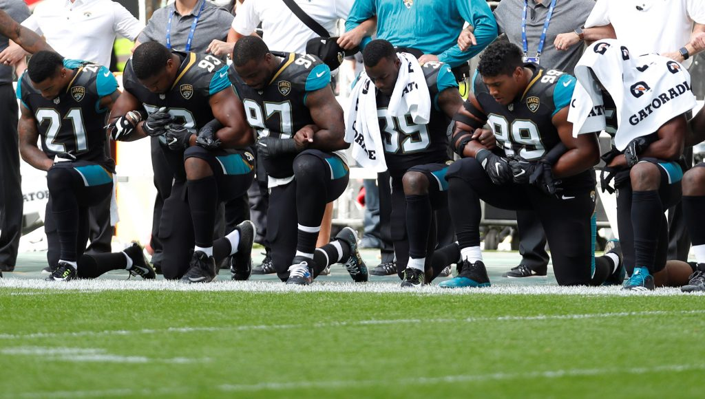 Jacksonville Jaguars players kneel during the U.S. national anthem before a match this past weekend. Photo by Paul Childs/Reuters