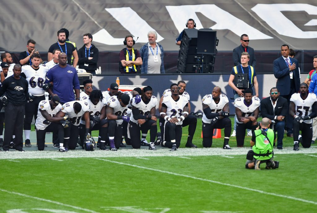 Thirteen Baltimore Ravens players kneel as the national anthem is played before the game between the Jacksonville Jaguars and the Ravens. Photo by Steve Flynn/USA TODAY Sports via Reuters