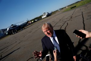 President Donald Trump speaks with reporters before boarding Air Force One in Morristown, New Jersey. Photo by Aaron P. Bernstein/Reuters