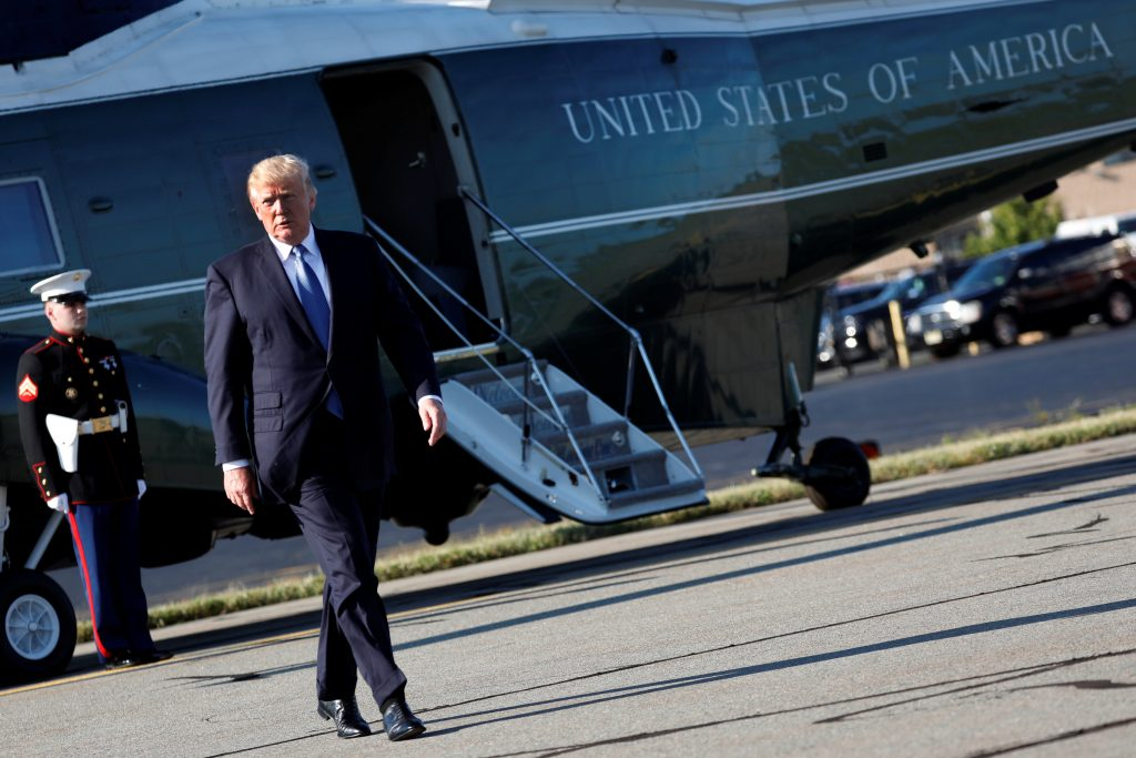 File photo of President Donald Trump walking to Air Force One. Photo by Aaron P. Bernstein/Reuters