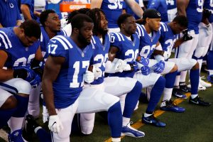 Indianapolis Colts players kneel during the playing of the National Anthem before the game against the Cleveland Browns at Lucas Oil Stadium. Mandatory Credit: Brian Spurlock-USA TODAY Sports/File Photo