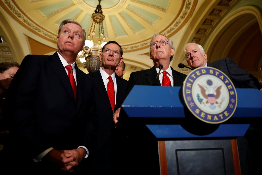 Senate Majority Leader Mitch McConnell, accompanied by (L-R) Sen. Lindsey Graham (R-SC), Sen. John Barrasso (R-WY) and Sen. John Cornyn (R-TX), speaks with reporters following the party luncheons on Capitol Hill in Washington, U.S., September 26, 2017. REUTERS/Aaron P. Bernstein - RC1578663BA0