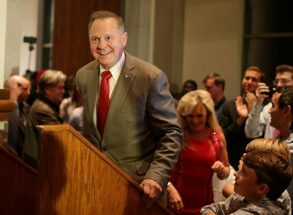 Republican candidate Roy Moore enters the stage to make his victory speech after defeating incumbent Luther Strange to his supporters at the RSA Activity center in Montgomery, Alabama, U.S. September 26, 2017, during the runoff election for the Republican nomination for Alabama's U.S. Senate seat vacated by Attorney General Jeff Sessions. REUTERS/Marvin Gentry - RC1A4F1B1750