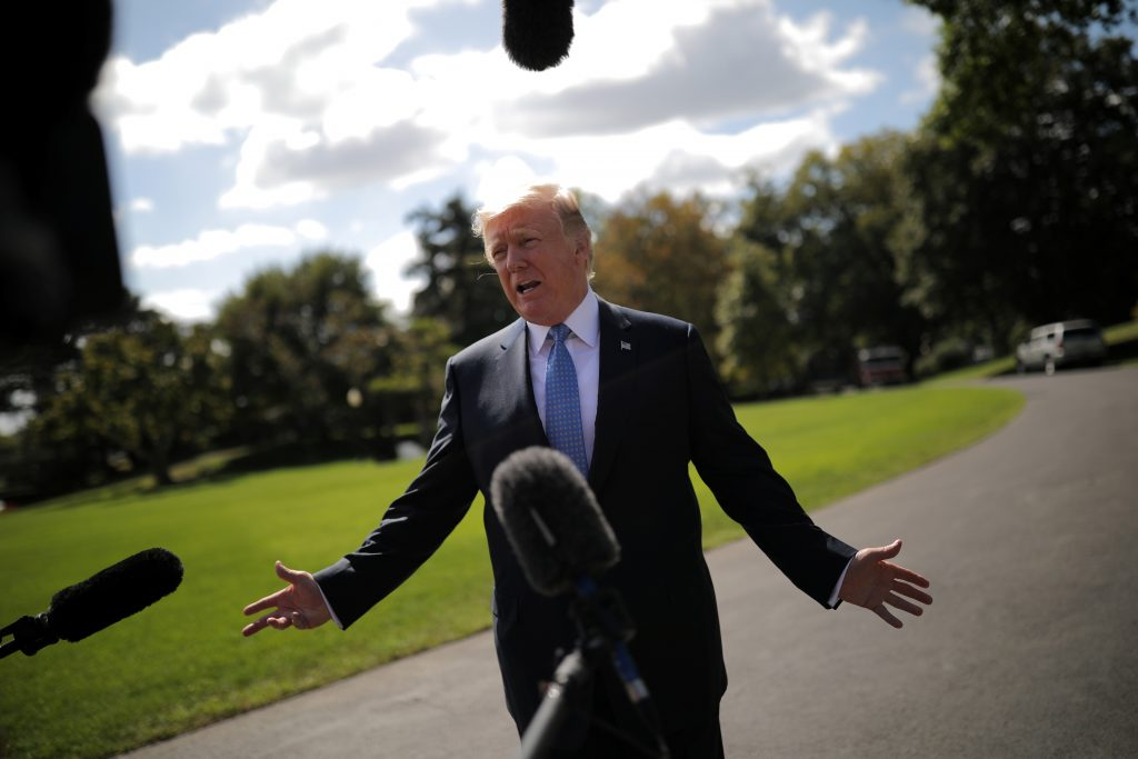 President Donald Trump talks with reporters as he departs the White House for Indianapolis, in Washington, D.C. Photo by Carlos Barria/Reuters