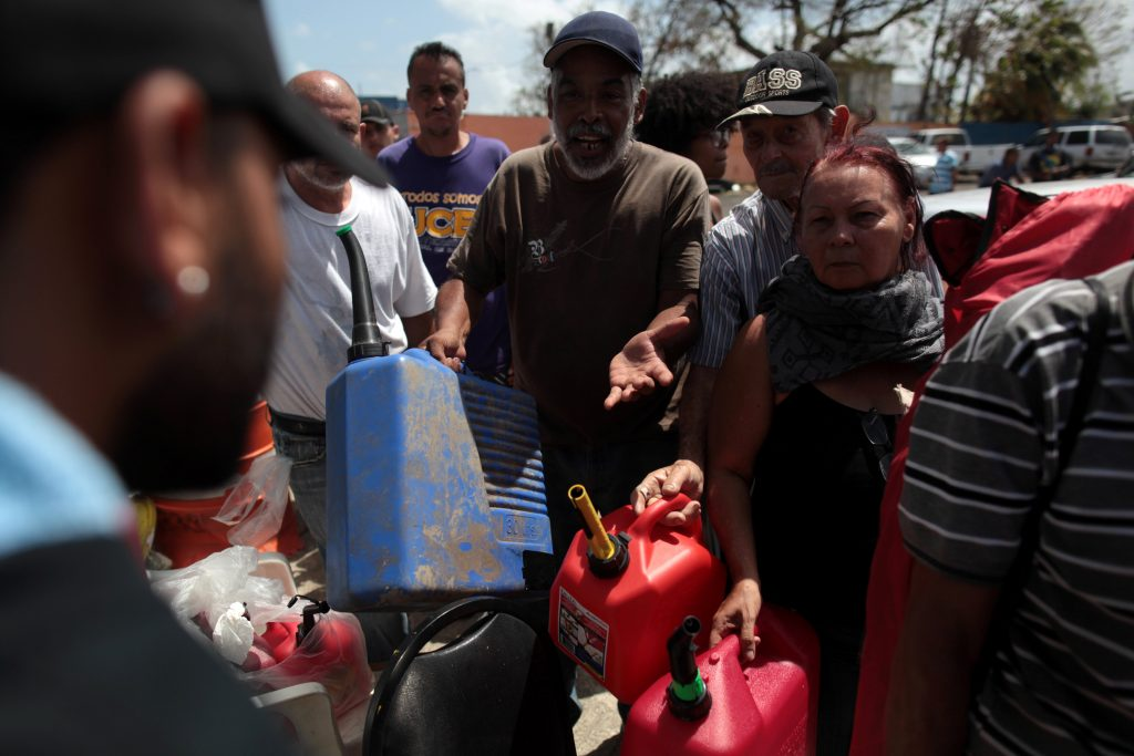 People queue at a gas station to fill up their fuel containers, after the island was hit by Hurricane Maria, in San Juan