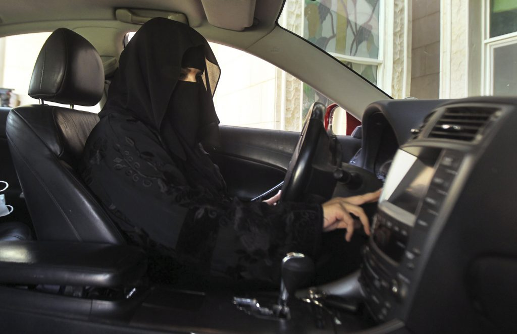 A woman drives a car in Saudi Arabia in 2013. Photo by Faisal Al Nasser/Reuters