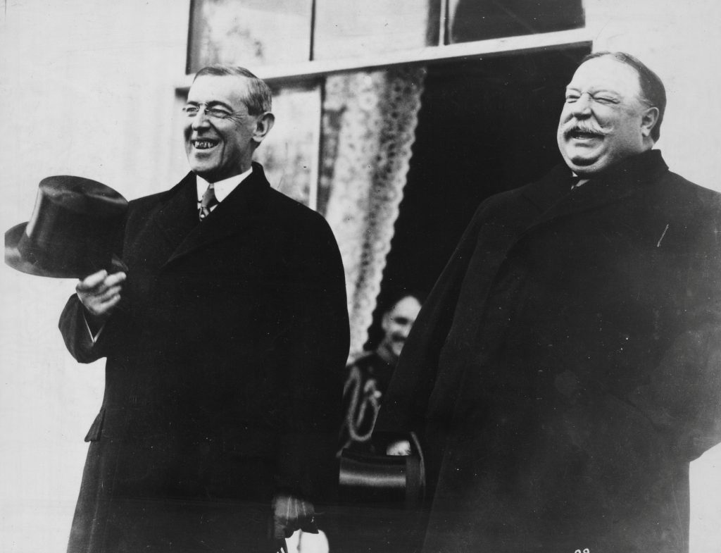 President-elect Woodrow Wilson and President Taft laugh on the White House steps before departing together for Wilson's inauguration in Washington, D.C., U.S. in March 1913. Library of Congress/Handout via REUTERS ATTENTION EDITORS - THIS IMAGE WAS PROVIDED BY A THIRD PARTY. EDITORIAL USE ONLY - RC121B4D7850