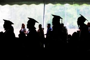 Graduating seniors line up to receive their diplomas during Commencement at Wellesley College in Wellesley