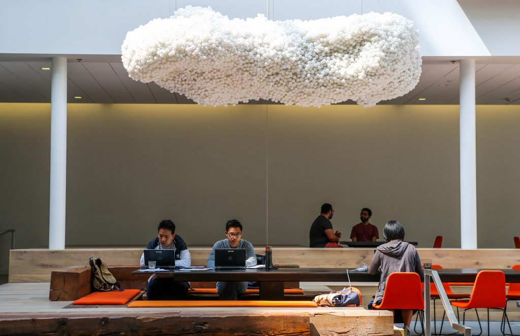 People worked in the lobby of the Airbnb office headquarters in the SOMA district of San Francisco, California, U.S., August 2, 2016. REUTERS/Gabrielle Lurie - RC185895A7E0
