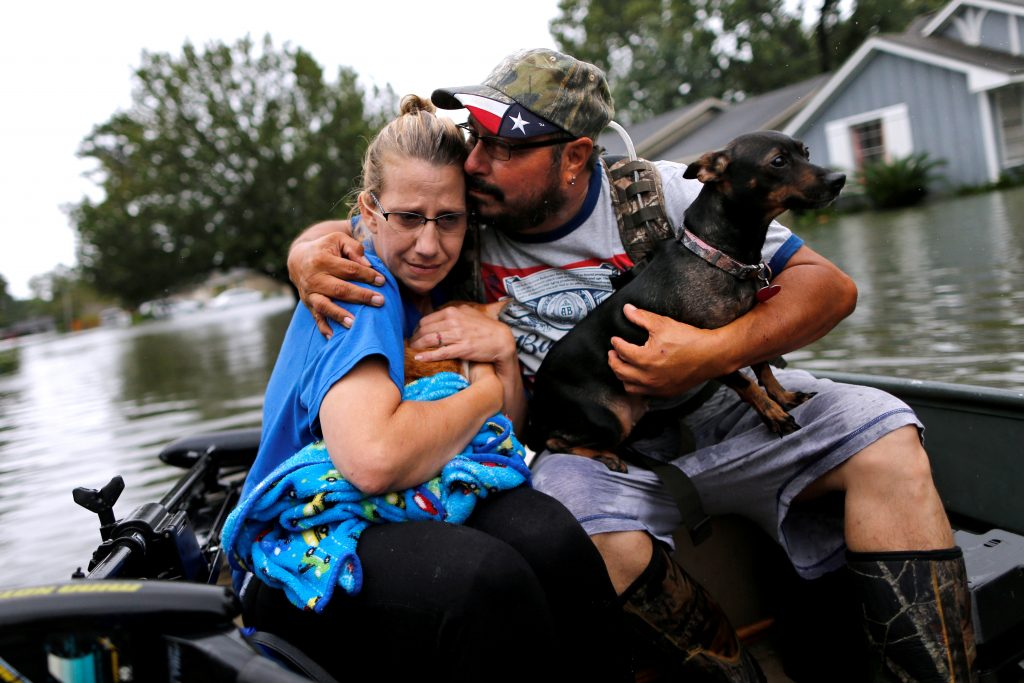 David Gonzalez comforts his wife Kathy after being rescued from their home flooded by Tropical Storm Harvey in Orange, Texas, on Aug. 30. Photo by Jonathan Bachman/Reuters