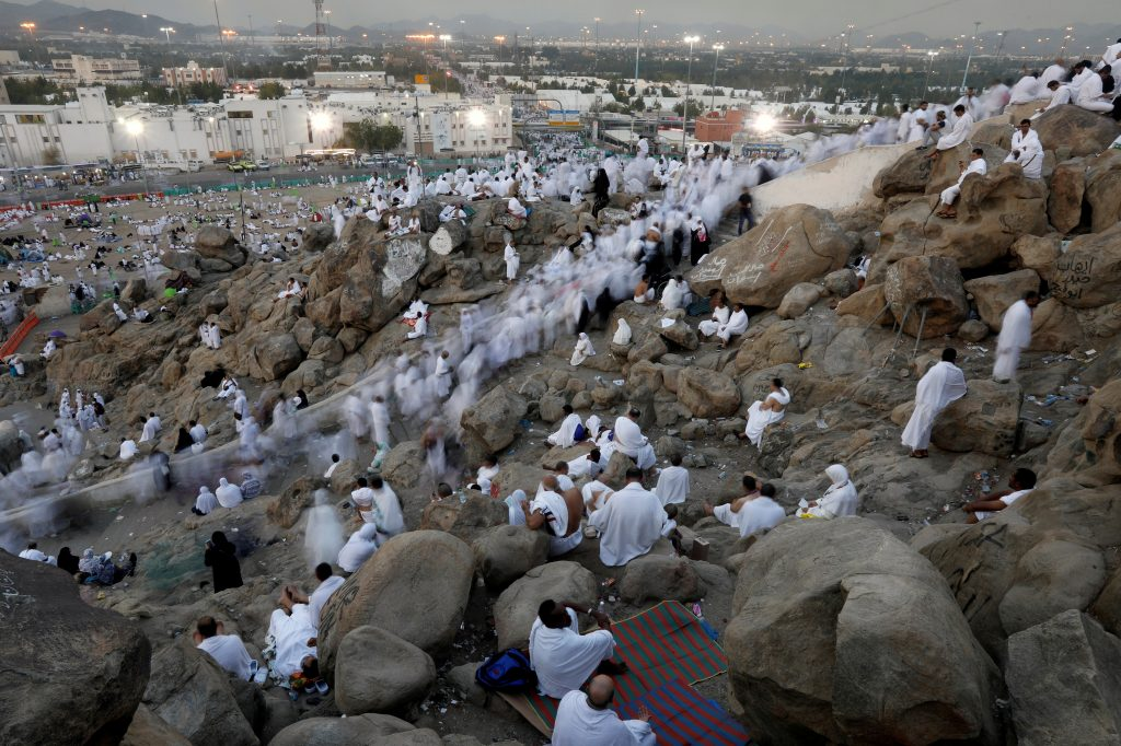 Muslim pilgrims gather on Mount Mercy on the plains of Arafat during the annual haj pilgrimage, outside the holy city of M...