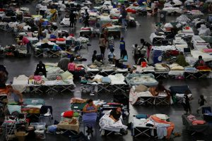 Evacuees affected by Tropical Storm Harvey take shelter at the George R. Brown Convention Center in downtown Houston, Texas, U.S.  August 31, 2017. REUTERS/Carlos Barria