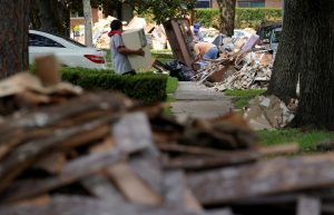 Giant mounds of trash from Hurricane Harvey flood damaged homes lines the sidewalks in Houston, Texas, U.S. September 2, 2017. REUTERS/Rick Wilking - RC122DDE7A50