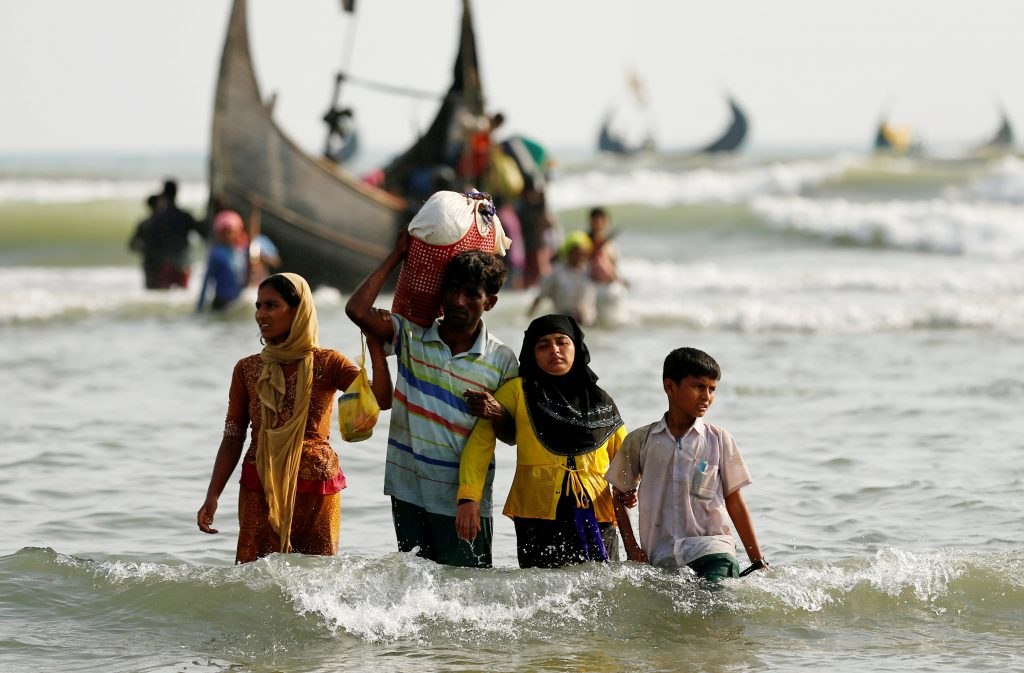 Rohingya refugees travel from the Bay of Bengal into Teknaf, Bangladesh, on Sept. 5. Photo by Mohammad Ponir Hossain/Reuters
