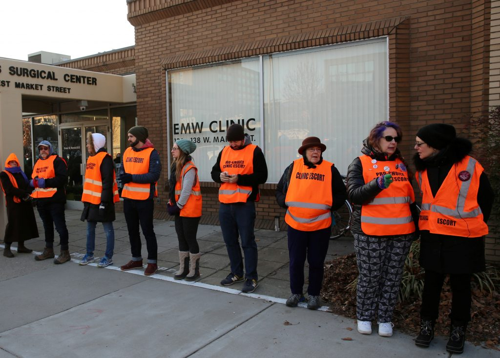 Escorts who ensure women can reach the clinic lineup as they face off protesters outside the EMW Women's Surgical Center in Louisville, Kentucky, U.S. on January 27, 2017. Picture taken July 27, 2017. REUTERS/Chris Kenning - RC19EE729960