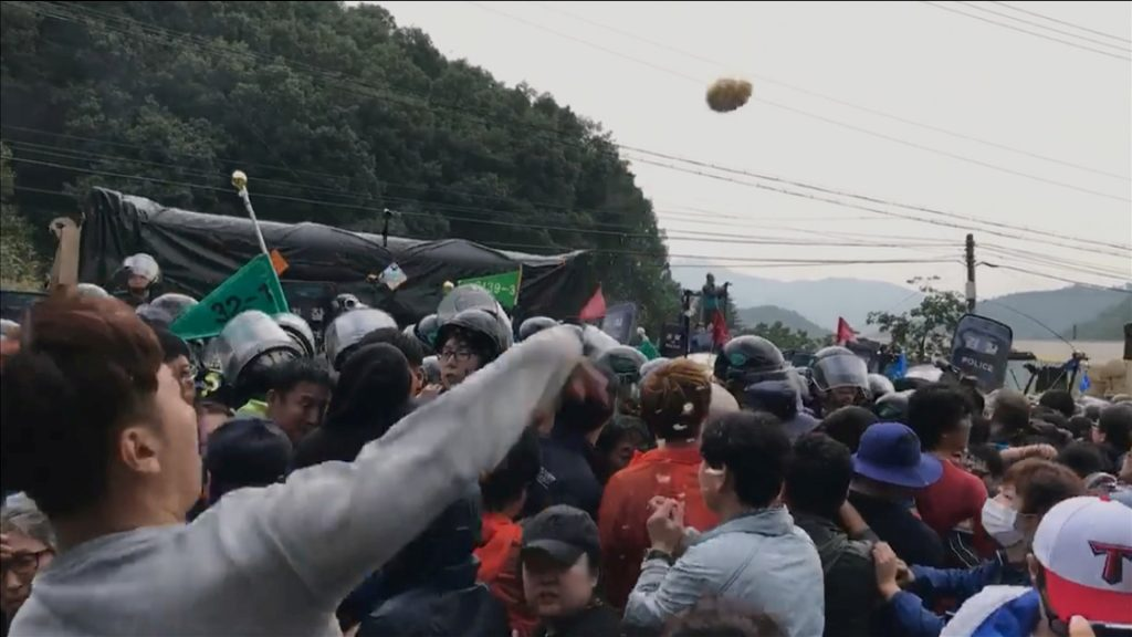 A protest in Seongju, South Korea, opposes the deployment of a Terminal High Altitude Area Defense (THAAD) system in this still image taken from a Sept. 7 social media video. Image by Han Sung/via Reuters