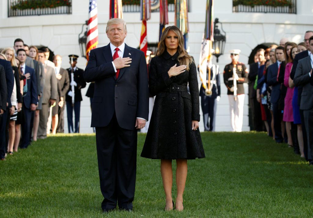 President Donald Trump and first lady Melania Trump observe a moment of silence at the White House on Sept. 11 in remembrance of lives lost in the 9/11 terrorist attacks. Photo by Kevin Lamarque/Reuters