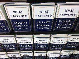 "Copies of Hilary Clinton's new book ""What Happened"" line shelves before she arrives for a book signing in Barnes & Noble Union Square in Manhattan, New York, US September 12 2017. REUTERS/Andrew Kelly - RC1C65D4A820"