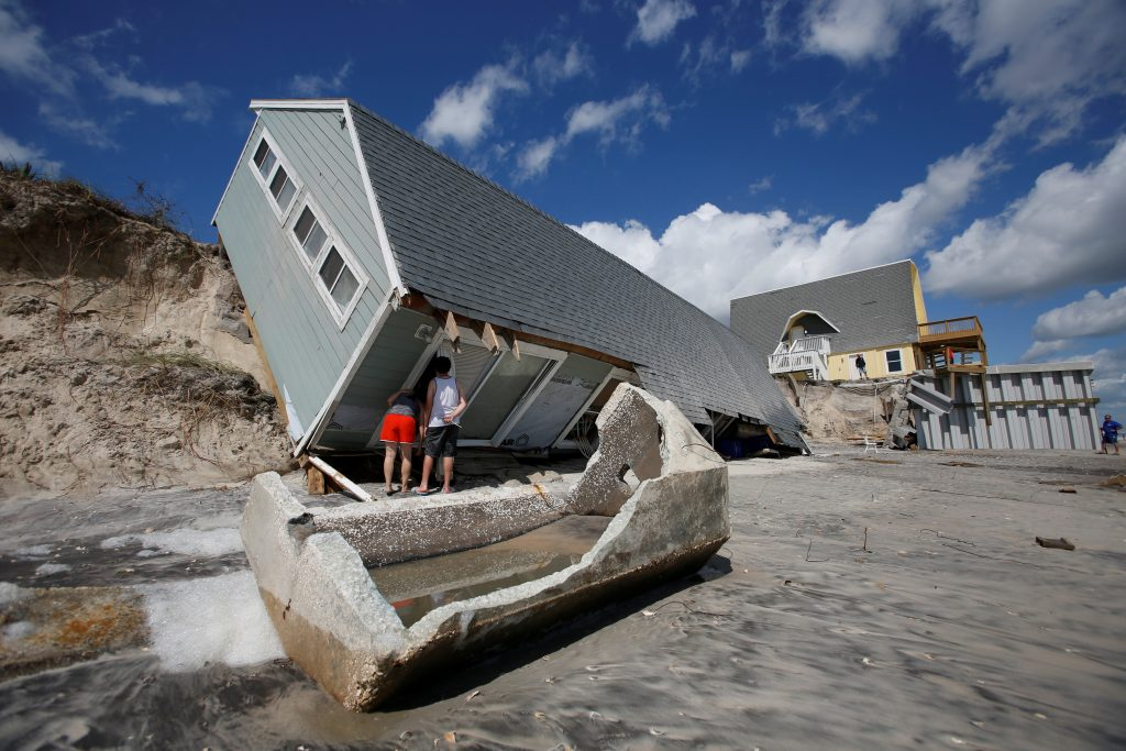 Local residents look inside a collapsed coastal house after Hurricane Irma passed the area in Vilano Beach, Florida. Photo by Chris Wattie/Reuters