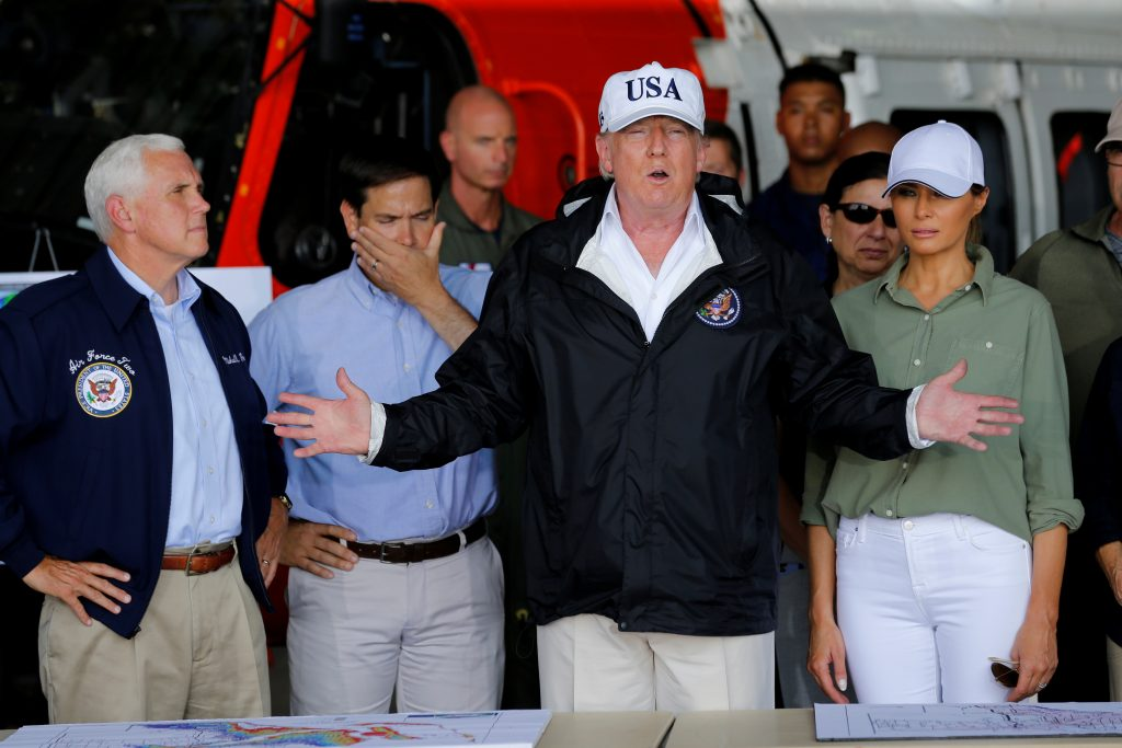 U.S. President Donald Trump speaks between first lady Melania Trump and Vice President Mike Pence (L) and Senator Marco Rubio (R-FL) (2ndL) while receiving a briefing on Hurricane Irma relief efforts in Fort Myers, Florida, U.S., September 14, 2017. REUTERS/Jonathan Ernst