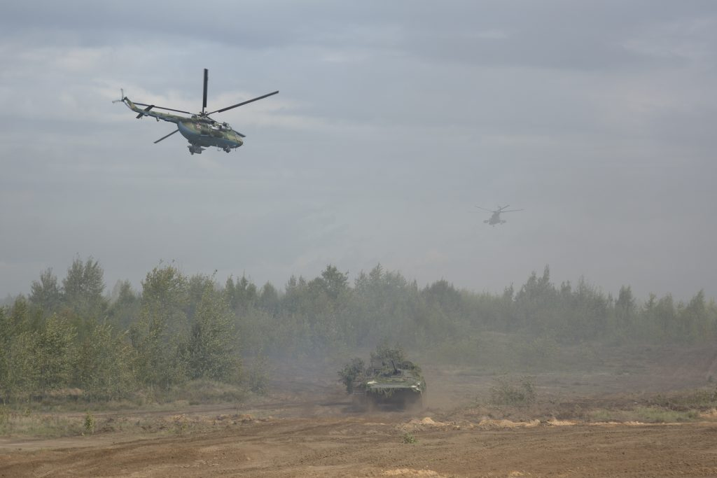 Helicopters and an armored vehicle are seen during the Zapad-2017 war games held by Russian and Belarussian servicemen on Sept. 14. Photo by Vayar military information agency/Belarussian Defense Ministry/Handout via Reuters