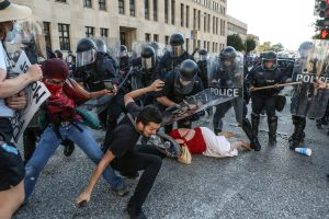 Protesters fall as they are pushed back by police in riot gear during a protest after a not guilty verdict in the murder trial of former St. Louis police officer Jason Stockley, charged with the 2011 shooting of  Anthony Lamar Smith, who was black, in St. Louis, Missouri. Photo taken Sept. 15, 2017. Photo by Lawrence Bryant/Reuters
