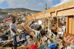 A resident of St. Thomas in the U.S. Virgin Islands surveys his home on September 16, 2017, almost two weeks after Hurricane Irma wrought havoc to the island. Now, the islands are under hurricane watch as Hurricane Irma approaches. Credit: REUTERS/Jonathan