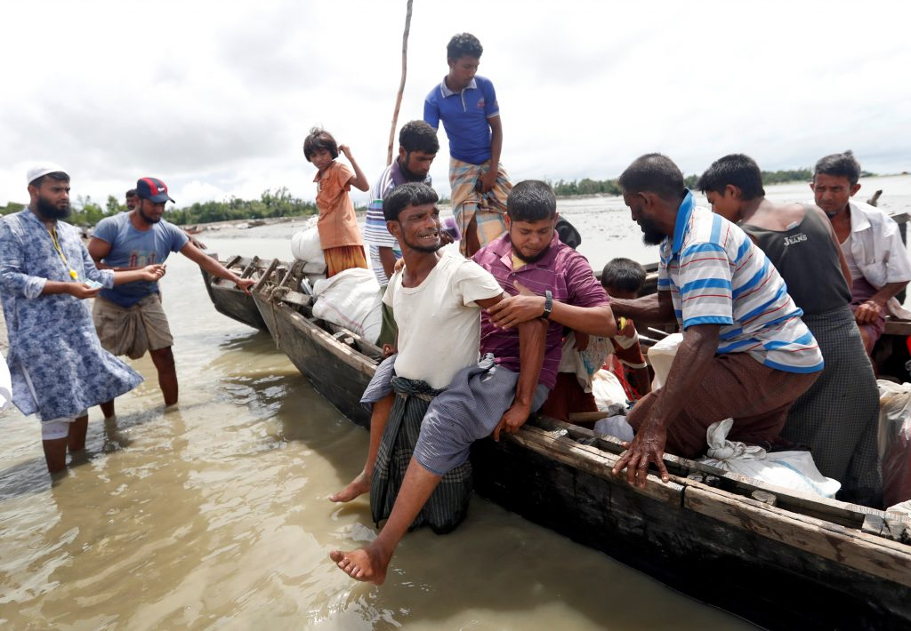 Rohingya refugees are seen in a boat after their arrival at Cox's Bazar, Bangladesh on Sept. 18. Photo by Cathal McNaughton/Reuters