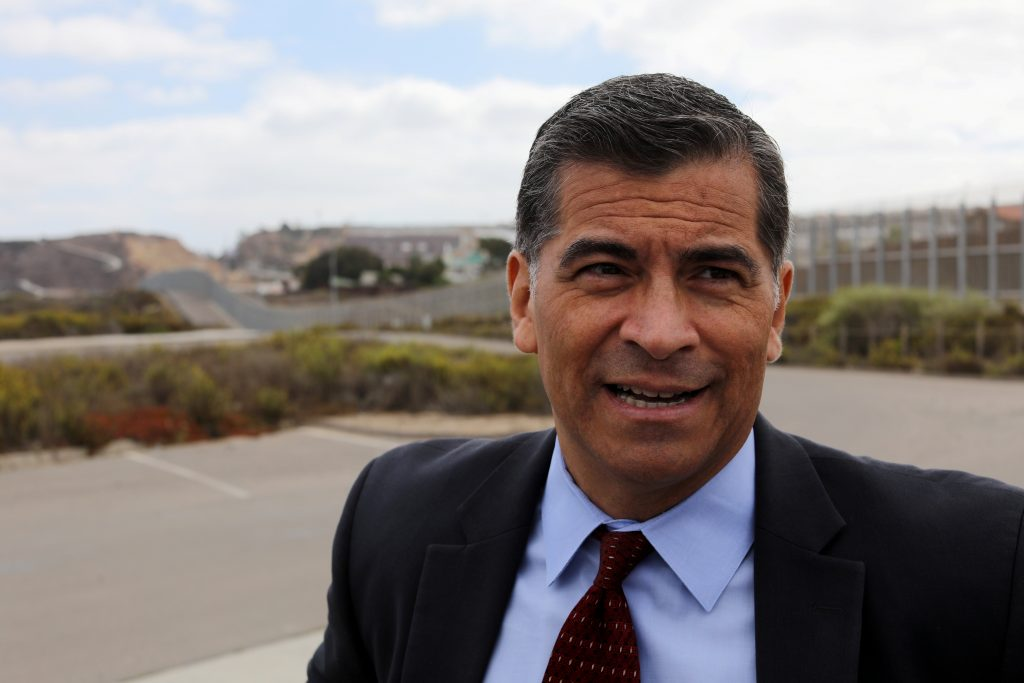 California Attorney General Xavier Becerra walks along the U.S. Mexico border after announcing a lawsuit against the Trump Administration over its plan to begin construction of border wall projects in San Diego and Imperial Counties in San Diego, California, U.S. September 20, 2017. REUTERS/Mike Blake - RC1A1F5B3F80