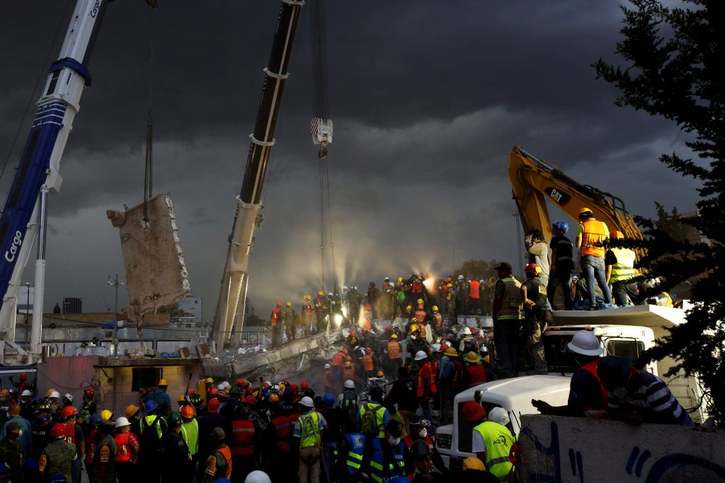 Rescue teams worked into the night in the Obrera neighborhood in Mexico City, Mexico on Sept. 20. Photo by Carlos Jasso/Reuters