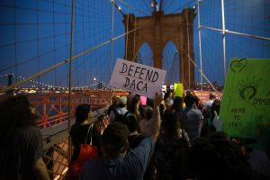 People march across the Brooklyn Bridge to protest the planned dissolution of DACA in New York City on Sept. 5. Photo by Stephen Yang/Reuters